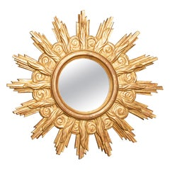 French Midcentury Carved Giltwood Sunburst Mirror with Cloudy Frame