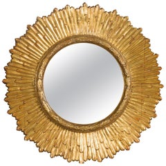 French Midcentury Giltwood Sunburst Mirror with Radiating Rays and Carved Frame