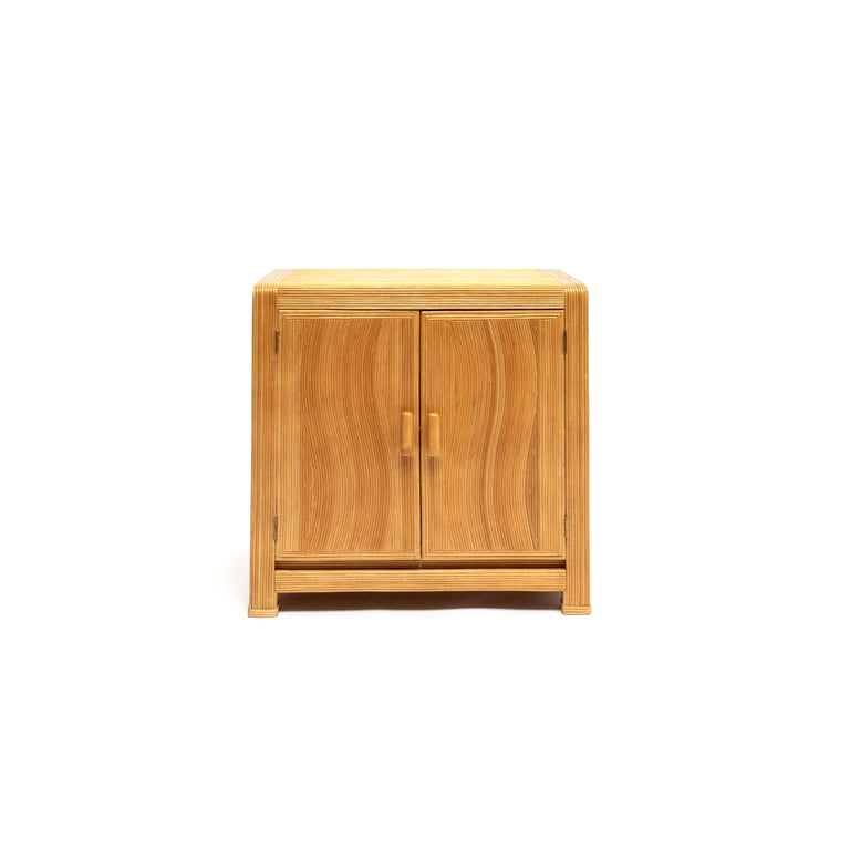 A vintage compact bamboo cabinet. Wavy applied split bamboo veneer over solid wood case construction. This piece is a great way to introduce warmth and texture into your space, French, circa 1950.
