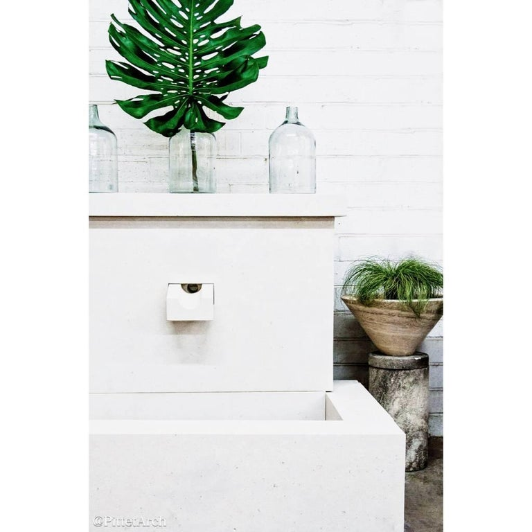 This French modern limestone fountain with sleek, clean lines is a wonderful addition to your courtyard.  Origin: France  Measurements: 63 3/16
