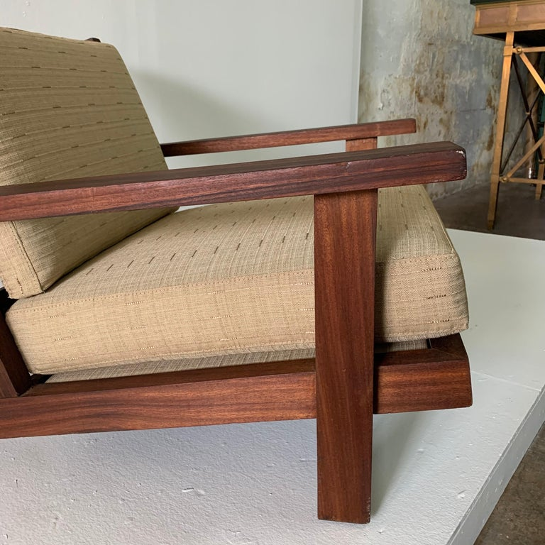 This is a wide, deep and low all teak armchair from France, made in 1960s. Finished with a beach-vibe fabric in neutral tones. This was acquired from the Estate of Amy Perlin, New York. There is a second similar style chair with a higher back