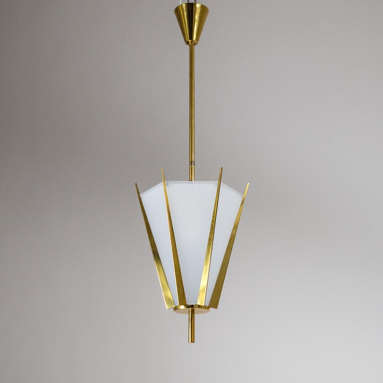 Fabulous French midcentury brass pendant or lantern, circa 1960. Hexagonal crown-like structure in brass with opaque acrylic diffuser panels. This is an extremely well designed and constructed piece with precision-tooled custom elements. Very good
