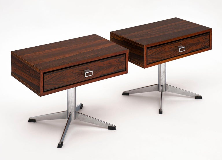 Pair of French Modernist side tables made of Macassar of ebony. Each table features one drawer with a chromed steel finish on the base.
