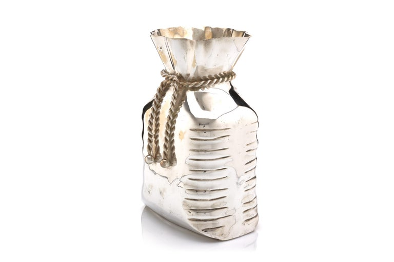 A fine and entertaining vase in the form of a bag of money, finely crafted out of silvered bronze.