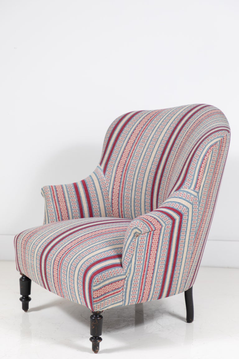 French Napoleon chair newly upholstered in a beautiful woven textile from British textile design, Susan Deliss. The chair offers Classic lines. Feet are original.
