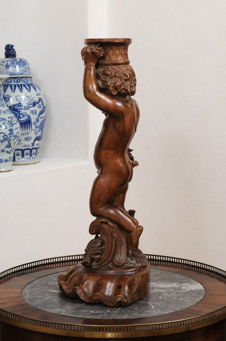French Napoléon III 1860s Carved Walnut Sculpture of a Putto Carrying a Vessel For Sale 7