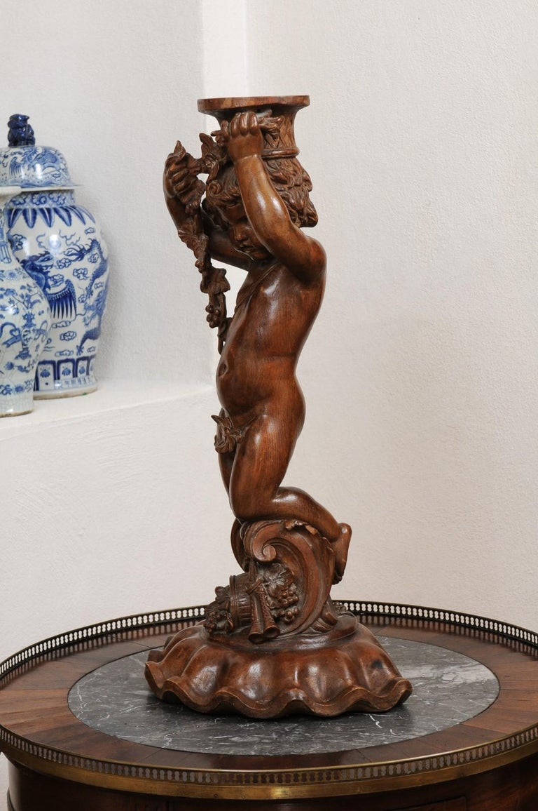 French Napoléon III 1860s Carved Walnut Sculpture of a Putto Carrying a Vessel For Sale 8