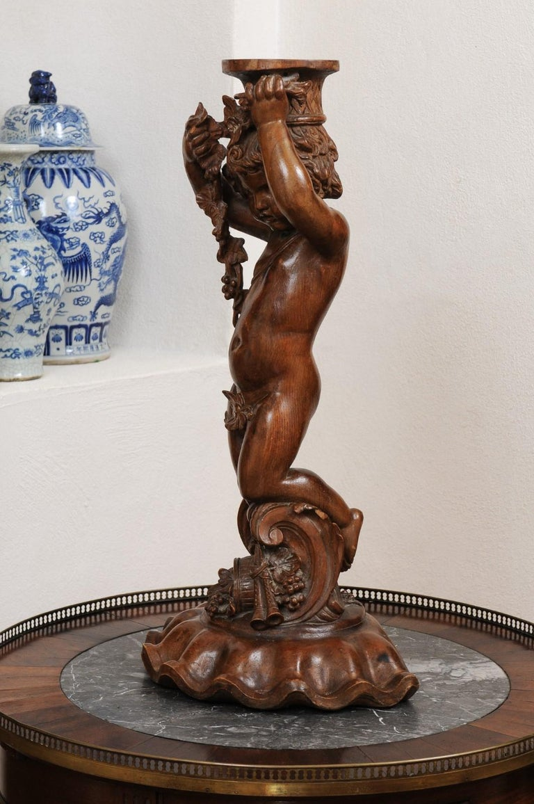 French Napoléon III 1860s Carved Walnut Sculpture of a Putto Carrying a Vessel For Sale 9