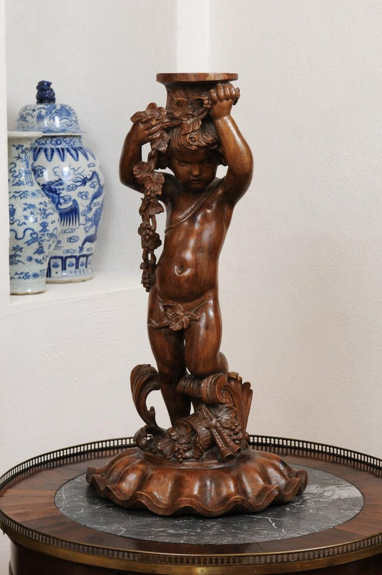 French Napoléon III 1860s Carved Walnut Sculpture of a Putto Carrying a Vessel For Sale 10