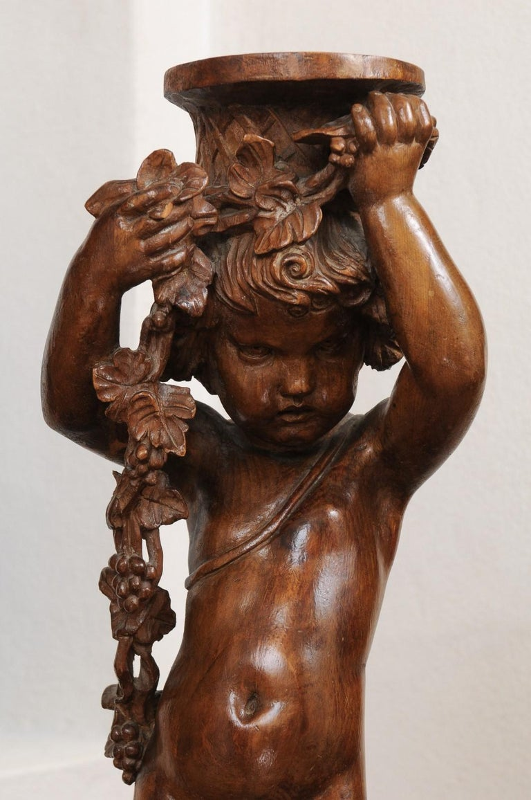 French Napoléon III 1860s Carved Walnut Sculpture of a Putto Carrying a Vessel For Sale 11