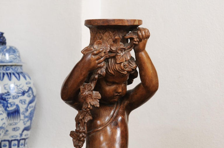 French Napoléon III 1860s Carved Walnut Sculpture of a Putto Carrying a Vessel In Good Condition For Sale In Atlanta, GA