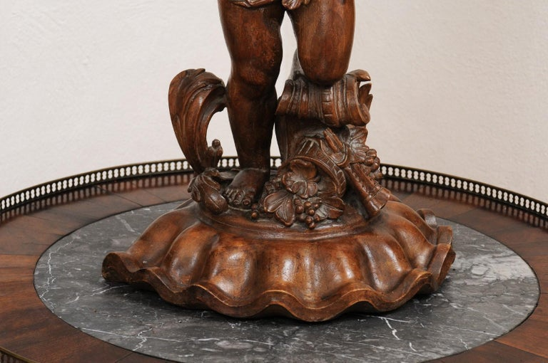 French Napoléon III 1860s Carved Walnut Sculpture of a Putto Carrying a Vessel For Sale 1