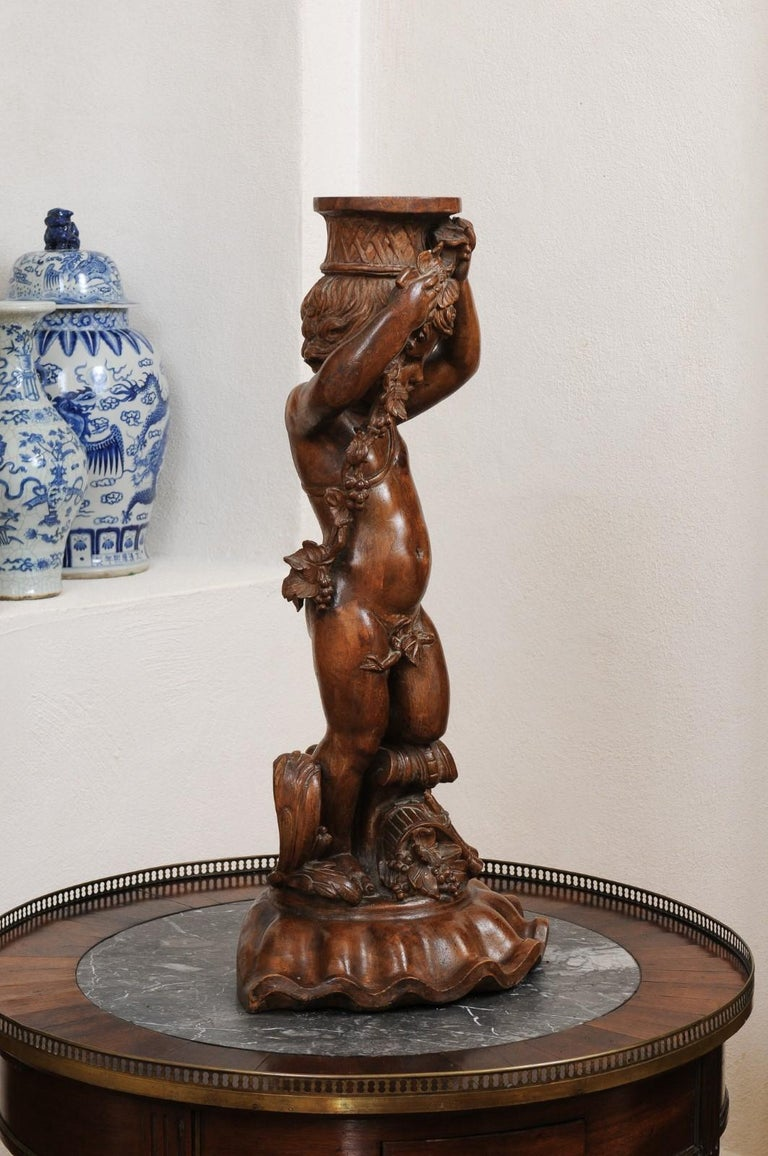 French Napoléon III 1860s Carved Walnut Sculpture of a Putto Carrying a Vessel For Sale 2