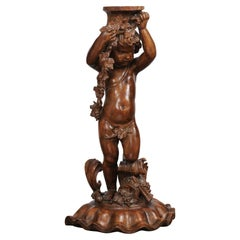 French Napoléon III 1860s Carved Walnut Sculpture of a Putto Carrying a Vessel