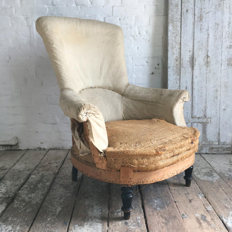 Napoleon III French stripped back armchair. Hessian seat with original hair/straw filling. Calico to the seat back and arms. Wooden frame.