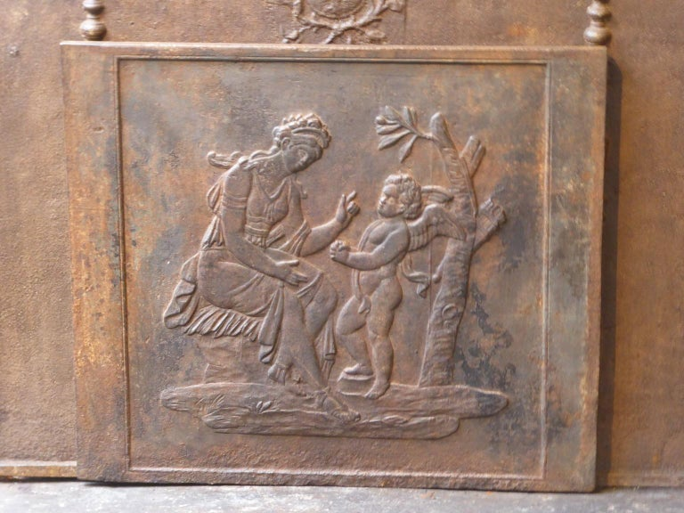 19th century French fireback with the goddess Diana. Goddess of hunting, also protector of animals of the forest, especially the young animals. She experienced great pleasure in hunting, but took care that she did not kill more animals than could be