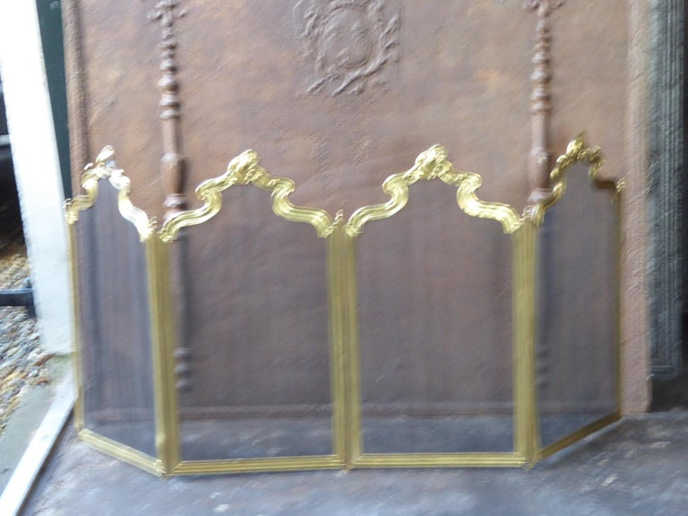 19th-20th century French Napoleon III four panel fireplace screen. The screen is made of brass and iron mesh.         .