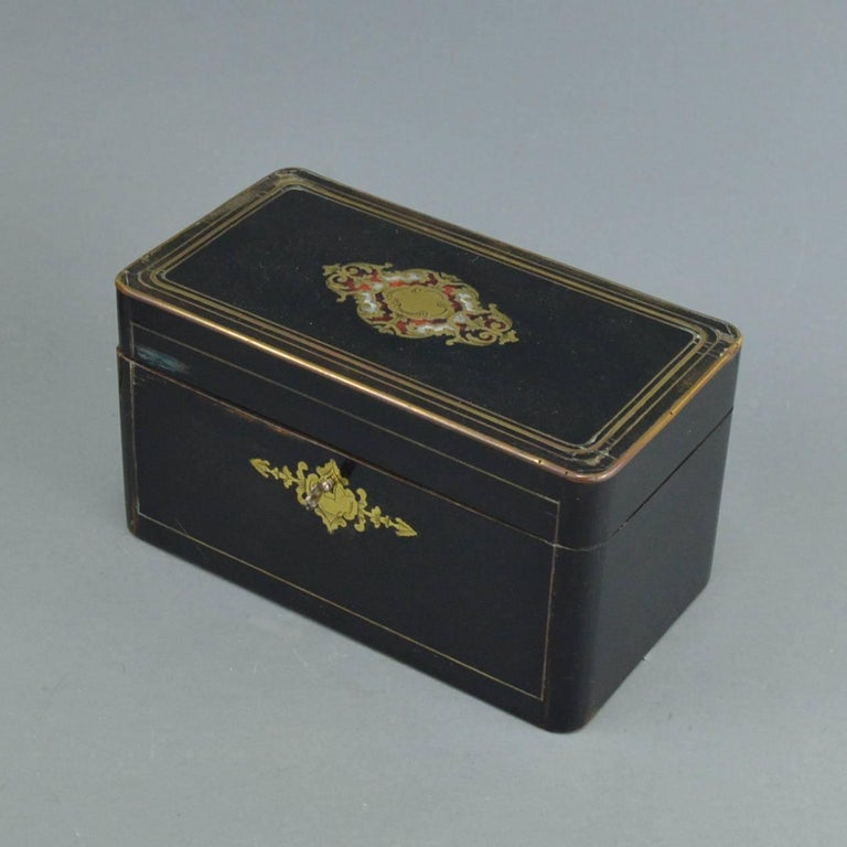 French Napoleon III marquetry tea box with beautiful yellow metal inlays, 19th century, 1850-1880.