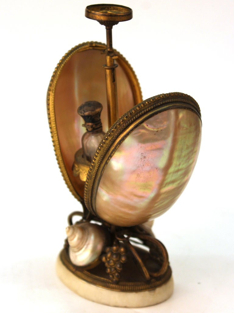Neoclassical Revival French Nautilus Shell and Ormolu Gilt Metal Mounted Egg-Shaped Mechanical Holder For Sale