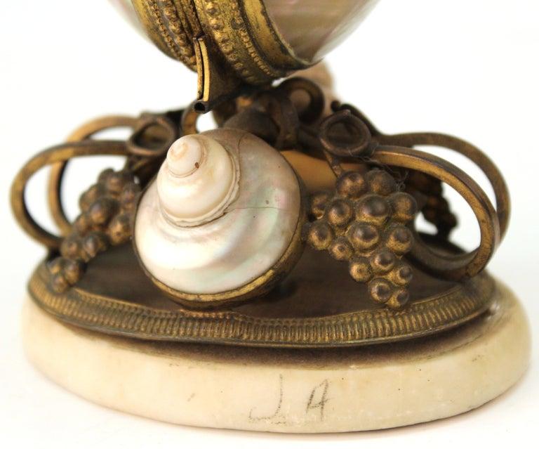 French Nautilus Shell and Ormolu Gilt Metal Mounted Egg-Shaped Mechanical Holder For Sale 1