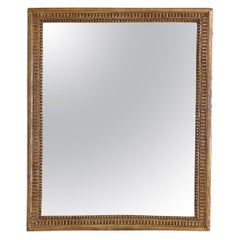 French Neoclassic Carved Giltwood Wall Mirror, First Quarter 19th Century