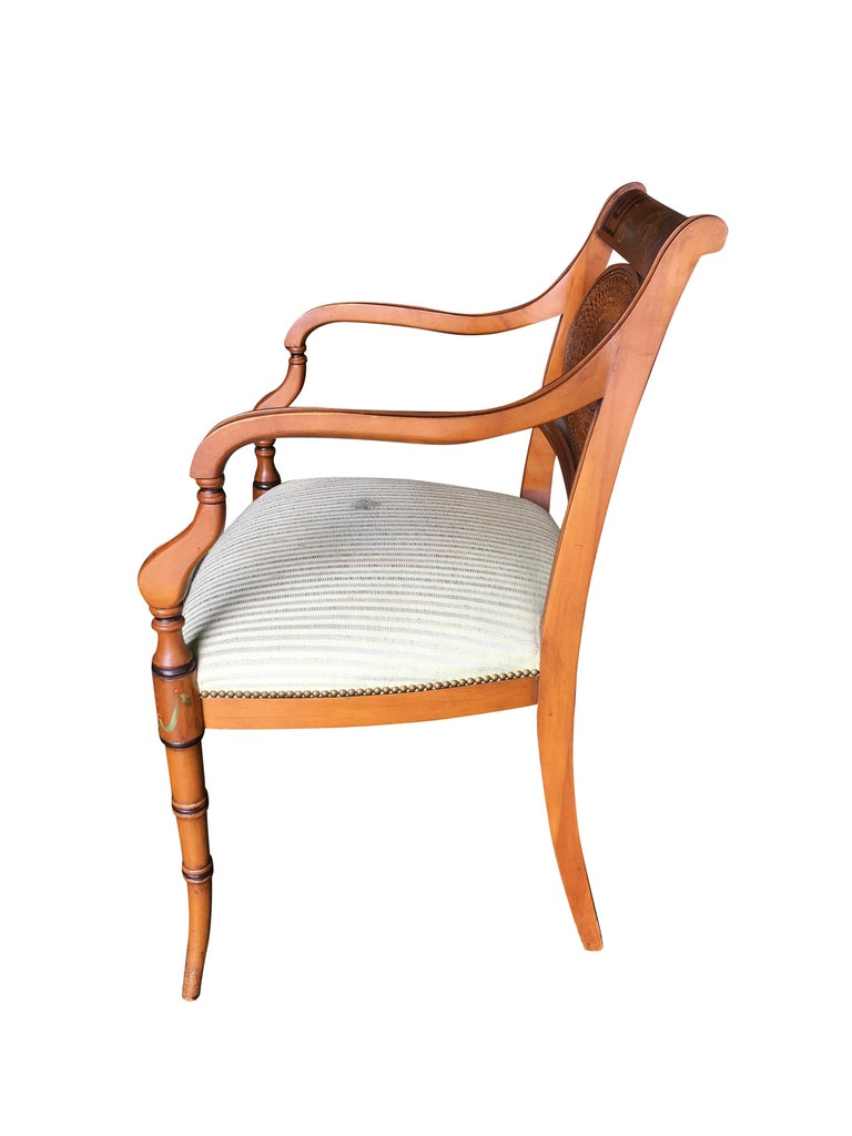 French neoclassic dining chair with hand-painted woven wicker back and sculpted legs.
