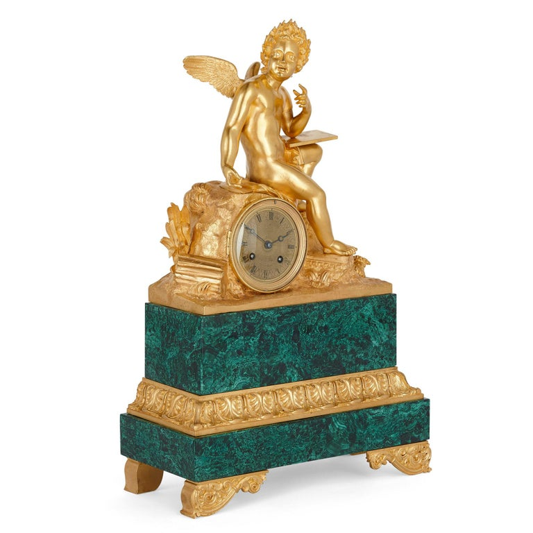 French neoclassical malachite and gilt bronze mantel clock French, circa 1830 Measures: Height 51cm, width 33cm, depth 14cm  This mantel clock is a fine example of the Charles X style. The clock, wrought from malachite and gilt bronze, features