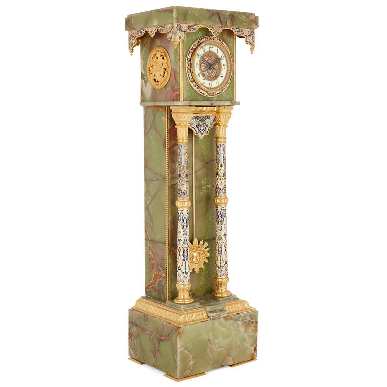 French neoclassical style enamel, onyx, and gilt bronze pedestal clock French, late 19th century Measures: Height 125cm, width 36cm, depth 30cm  This beautiful pedestal clock has been crafted from green onyx and beautifully decorated with gilt