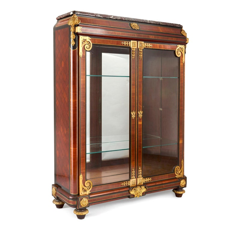 French neoclassical style gilt bronze mounted ebonized wood display cabinet