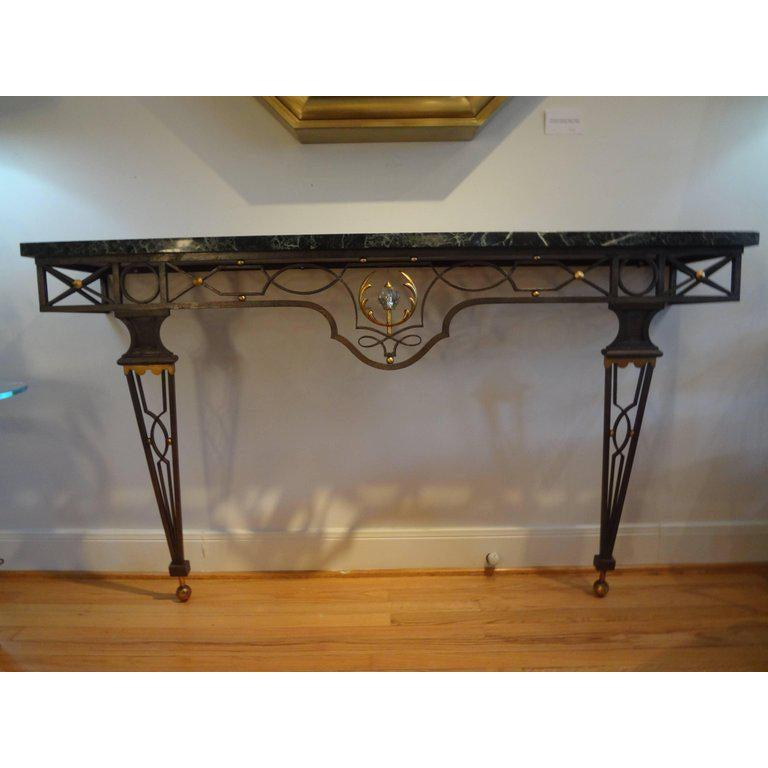 Outstanding large French neoclassical style wrought iron console table inspired by Gilbert Poillerat, 1940s. This stunning large French console is wall-mounted and has great proportions. This versatile neoclassical style console table or demilune