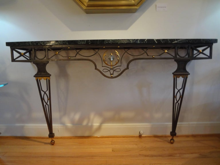 Outstanding large French Neoclassical style wrought iron console table inspired by Gilbert Poillerat, 1940s. This stunning large French console is wall-mounted and has great proportions. This versatile console table would work well in many