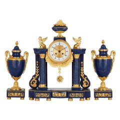 French Neoclassical Style Lapis and Gilt Bronze Clock Set