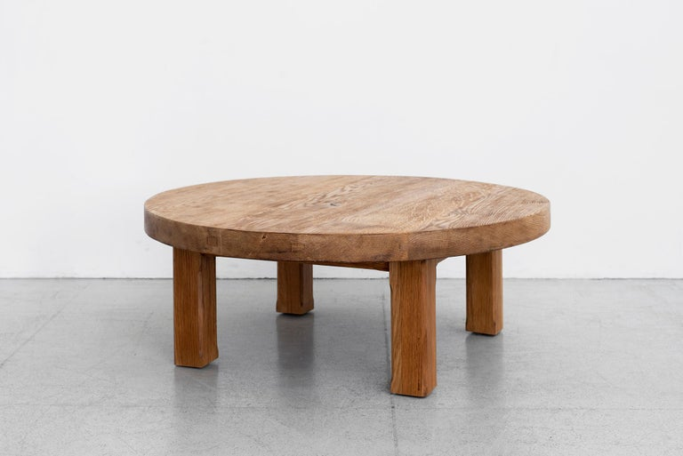 Solid French oak coffee table with thick slab top that has wonderful grain and patina.
