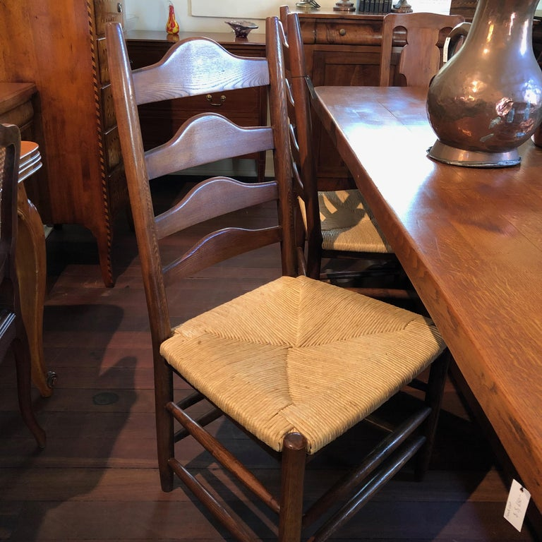 French Provincial French Oak Grand Ladder Back, Rush Seating Dining Chairs, Pair For Sale