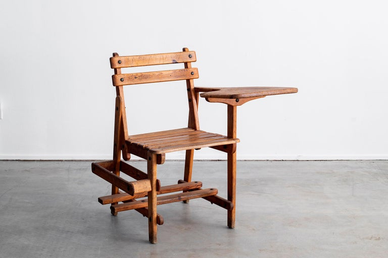 Charming old French school desk and chair with book holder. Oak slatted seat with great patina, circa 1940s.