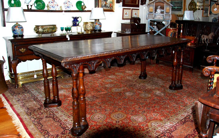French oak seven foot long dining table constructed from 17th century altar rail and balusters. We had this 17th century altar rail for many years and expected to use it on our balcony, but never got around to doing that. It was such a wonderful