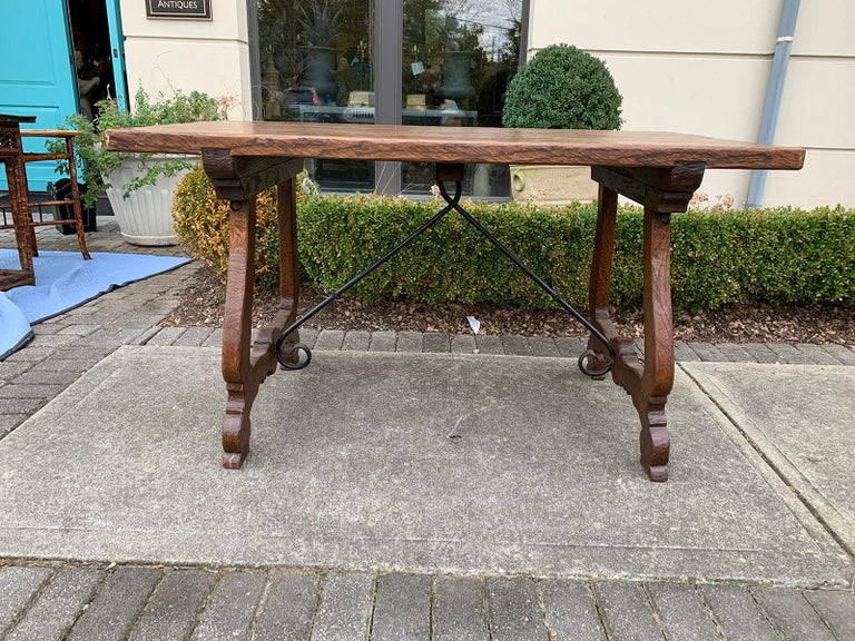 French oak trestle table with iron stretcher, circa 1880. Measures: 55