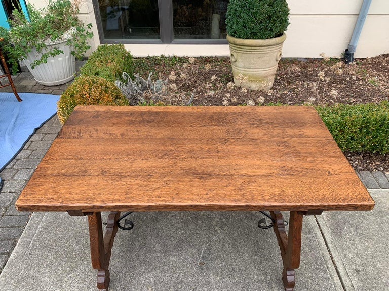 Late 19th Century French Oak Trestle Table with Iron Stretcher, circa 1880