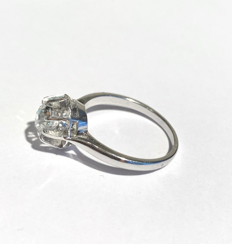 Ring set with a 1.11 carat diamond, french old cut.  Color of the diamond : G/H  Clarity : P1  Ring : 18 carats, 750/000th white gold (eagle's head hallmark punch)  Prong : platinum (wolf hallmark punch)  Size of the ring : 57 (FR) / 8