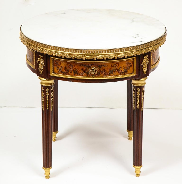 A French ormolu bronze and Vernis Martin low-table gueridon with marble top, circa 1880.