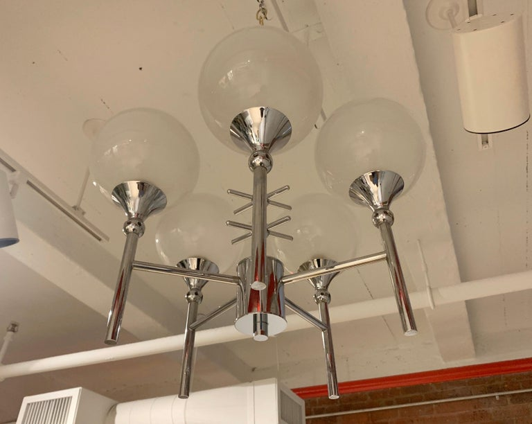 A wonderful French 1970s chrome 5-light fixture with opaline glass globe shades. Newly Rewired.