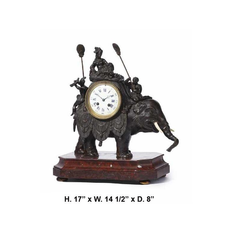 Spectacular French orientalist bronze patinated and rouge marble elephant clock, 19th century.