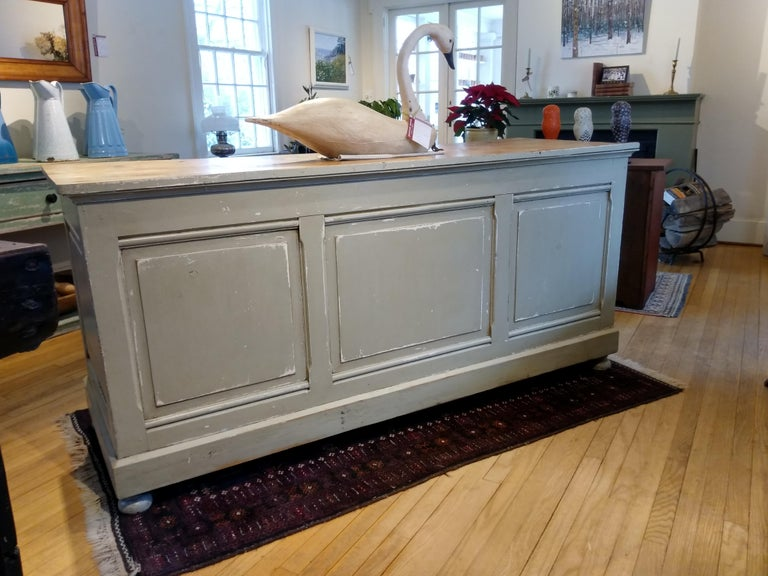 This circa 1880 store counter came from a variety store in the south of France. It has original hardware and three drawers, with a recessed shelf on the bottom for lots of storage. The base is painted a soft French blue-grey, and the other three