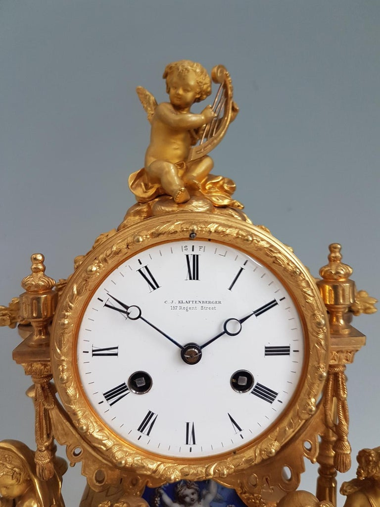 French ormolu and blue porcelain mantel clock. The blue porcelain with blue ground and decorated with baskets of flowers, fruit and doves, cherubs. A clock of the very highest quality, a beautiful example of the best of mid-19th century