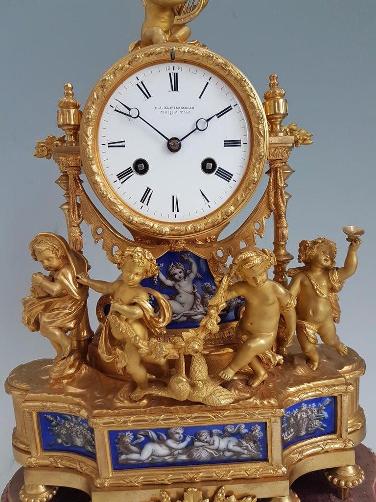 Napoleon III French Ormolu and Blue Porcelain Four Seasons Mantel Clock For Sale