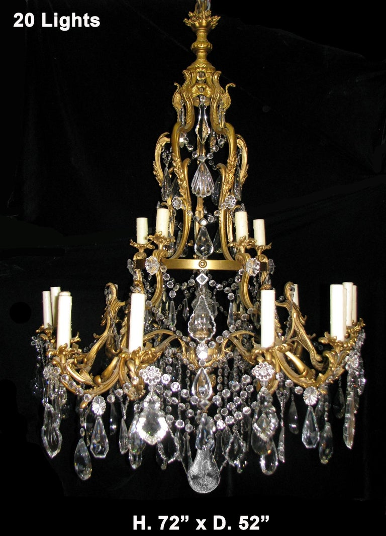 Spectacular large French Louis XV style ormolu and fine cut crystal two-tier twenty light chandelier,