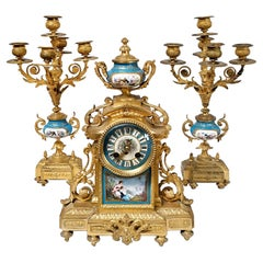 French Ormolu and Porcelain Mantle Clock and Pair of Candelabra, 19th Century