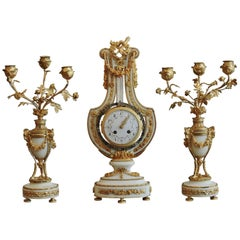 French Ormolu and White Marble Three-Piece Lyre Shaped Clock Garniture