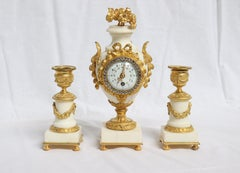 French Ormolu and White Marble Three-Pieces Vase Shaped Clock Garniture