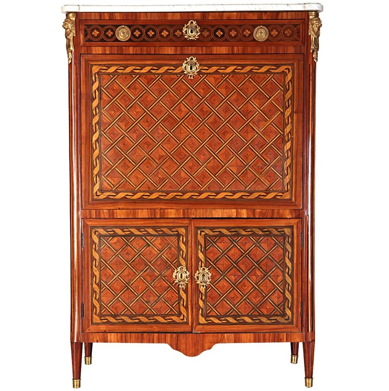 Important French ormolu-mounted, kingwood, tulipwood and stained sycamore marqueterie and parquetry secretaire abattant with rectangular moulded white marble top, above a frieze drawer inlaid with flower heads, fall front enclosing a leather-lined